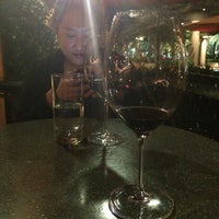 Photo taken at Bacchus Bar and Bistro by Kim Y. on 6/6/2014