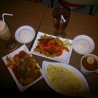 Photo taken at GUSTO Café n` Resto by Prishneesha K. on 12/31/2012
