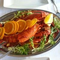 Photo taken at Deco Restaurant by Adam B. on 8/1/2013