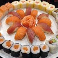 Photo taken at Sushicome by Jorge A. on 8/21/2014