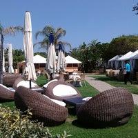 Photo taken at Atahotel Tanka Village Resort by Enrico T. on 7/17/2013