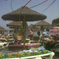 Photo taken at Playa Marina Beach by Sergio J. on 6/30/2013