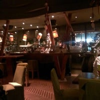 Photo taken at The Ivy by Nikolas A. on 12/31/2012