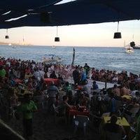 Photo taken at Mango Deck by Fernanda on 3/24/2013