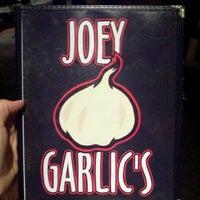 Photo taken at Joey Garlic's by Greg S. on 10/13/2012