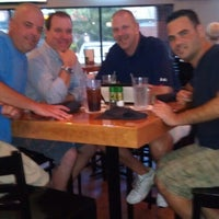 Photo taken at Chomps Sports Grill by Darin D. on 4/7/2013