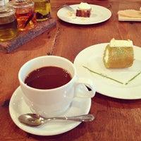 Photo taken at cafe 104.5 by Kiyoko O. on 4/12/2013