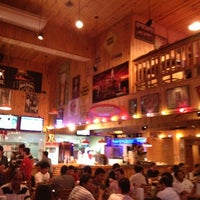 Photo taken at Hooters by Isabela M. on 1/12/2013