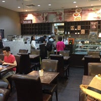 Photo taken at Theobroma Chocolate Lounge by Colby H. on 4/3/2014