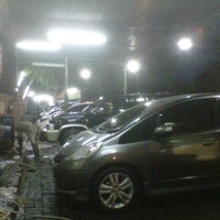 Photo taken at Arema Car Wash by Hendra on 1/6/2013