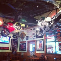 Photo taken at Quaker Steak & Lube® by Katherine Go on 10/25/2012