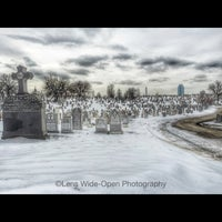 Photo taken at New Calvary Cemetery by Joey M. on 3/3/2015