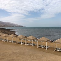 Photo taken at Dead Sea Beach (Holiday Inn Resort) by Ilan B. on 5/8/2018