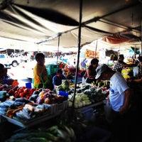 Photo taken at Hilo Farmers Market by Tomoko J. on 7/20/2013