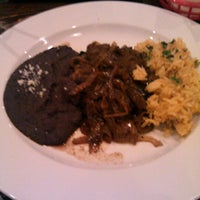 Photo taken at Micheladas Cafe y Cantina by Chris R. on 11/29/2012