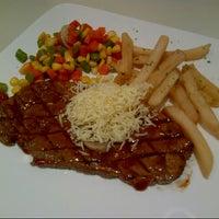 Photo taken at Steak 21 by Puri M. on 7/12/2013