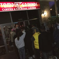 Photo taken at Stompin' Grounds Coffee & Cocktail Lounge by Glenn C. on 3/21/2016