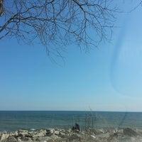 Photo taken at Bradford Beach by Bela A. on 4/4/2013