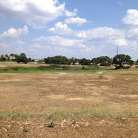 Photo taken at Olympic Heights Dog Park 1 by Jason C. on 7/6/2013