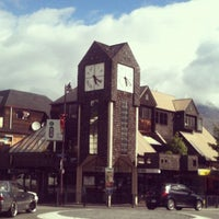 Photo taken at Queenstown Clocktower i-SITE by Esther M. on 12/7/2012