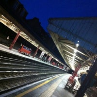 Photo taken at Barons Court London Underground Station by Matthew R. on 6/2/2011