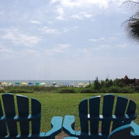 Photo taken at Bummz Beach Cafe by Jessica S. on 7/26/2014
