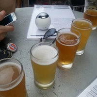 Photo taken at World of Beer by Ethan U. on 6/28/2013