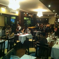 Photo taken at Backyard Grille Restaurant and Cafè by Dani S. on 12/6/2012