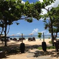 Photo taken at Nusa Dua Beach by Olya K. on 3/9/2013