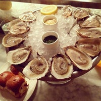 Photo taken at John Dory Oyster Bar by Gothamista on 2/12/2013