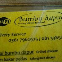 Photo taken at Warung BUMBU DAPUR JIMBARAN by Denny R. on 1/4/2013