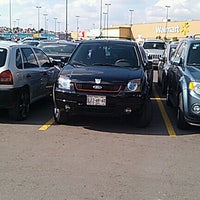 Photo taken at Estacionamiento by Andrews G. on 10/27/2013