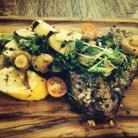 Photo taken at MOMO grill by Vija on 8/29/2014