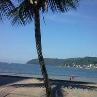Photo taken at Praia do Gonzaguinha by Michael A. on 4/28/2013