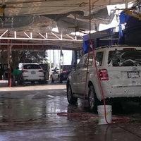 Photo taken at Greenwash Autolavados by Alejandro C. on 9/15/2014
