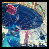 Photo taken at Silly Symphony Swings by Lew R. on 12/18/2012
