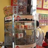 Photo taken at Churros City by Myra on 10/31/2012