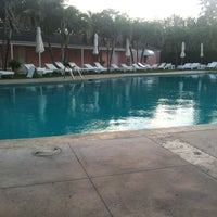 Photo taken at Lyford Cay Club Pool by Chamariz on 4/19/2013