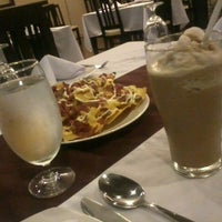 Photo taken at Backyard Grille Restaurant and Cafè by Neil S. on 11/3/2012