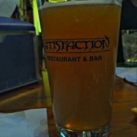 Photo taken at Satisfaction Restaurant & Bar by Peter C. on 11/11/2012