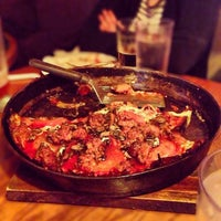 Photo taken at Pequod's Pizzeria by Abbey H. on 1/17/2013