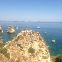 Photo taken at Quiosque Praia da Dona Ana by Anja on 8/9/2013
