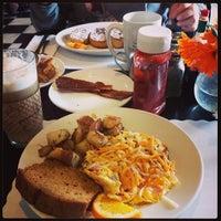 Photo taken at Toni's Courtyard Cafe by Mina on 3/29/2014