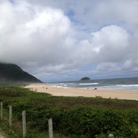 Photo taken at Praia de Grumari by Luli on 11/4/2012