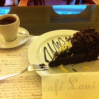 Photo taken at Café Louvre by Ronise on 2/12/2013