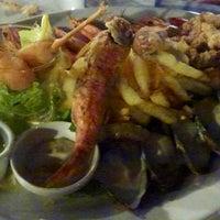 Photo taken at Pinia Restaurant by Irina H. on 8/18/2013