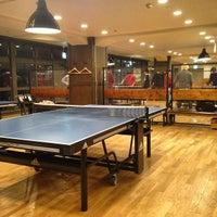 Photo taken at Shibuya Ping Pong Club by Taka P. on 12/18/2014