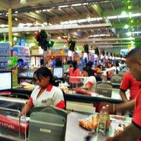 Photo taken at SuperMarket LHAU by Douglas K B. on 12/24/2012