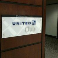 Photo taken at United Club by Eddy on 12/1/2012