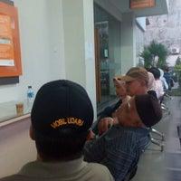 Photo taken at Bank BTPN Purnabakti Cililitan by Ade G. on 7/2/2016